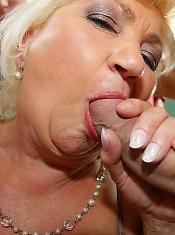 Kinky mature slut takes on five hard cocks