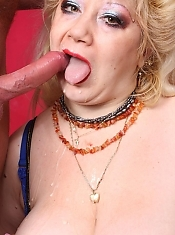 Big busted mature BBW Zhanna lets her knockers hang while she gets her pussy plugged with a cock live